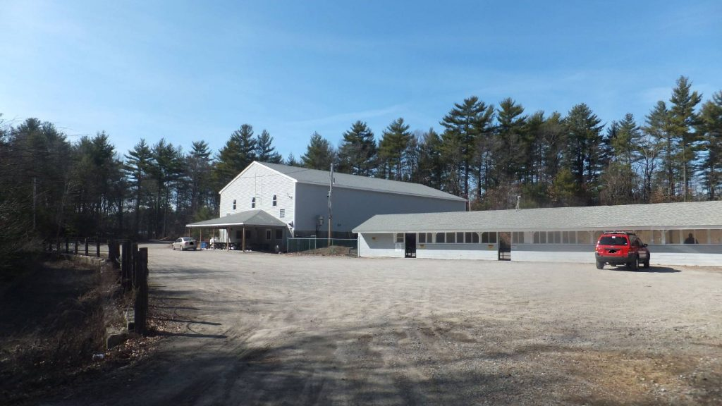 Images of the club facilities, including shooting and archery ranges and the classroom